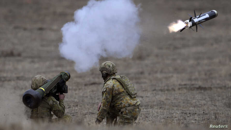 Australian Army soldiers fire a Javelin anti-tank missile during Excercise Chong Ju, a live fire demonstration showcasing the army's joint combined arms capabilities at the Puckapunyal Military Base near Melbourne on May 9, 2019.