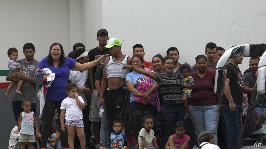 Migrants demand better conditions or that they be transferred to another center, at an immigration detention center in Tapachula, Chiapas State, Mexico, April 26, 2019.