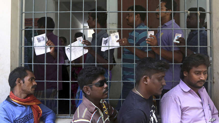 Indians stand in a queue to cast their votes during the second phase of India's general elections in Chennai, India, April 18, 2019. The Indian election is taking place in seven phases over six weeks in the country of 1.3 billion people.