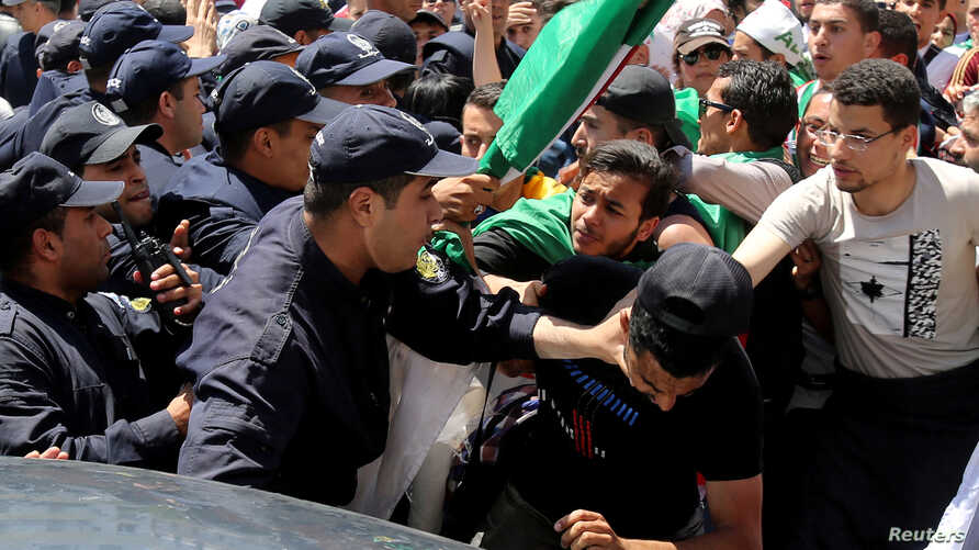 Demonstrators and police confront each other during an anti government protest in Algiers, Algeria, May 14, 2019.