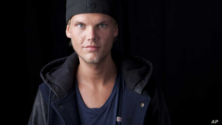 FILE - Swedish DJ, remixer and record producer Avicii poses for a portrait, in New York.
