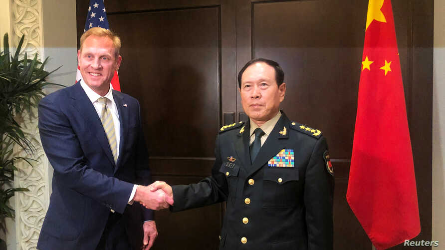 Acting U.S. Defense Secretary Patrick Shanahan and Chinese Defense Minister Wei Fenghe meet before the start of their meeting in Singapore on the sidelines of the Shangri-La dialogue, May 31, 2019.