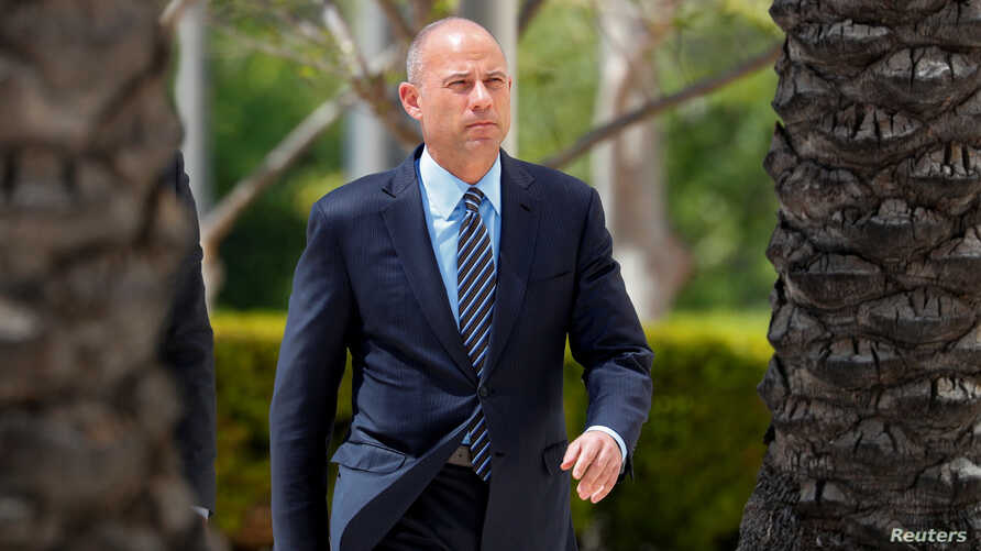 FILE - Attorney Michael Avenatti makes an initial appearance on charges of bank and wire fraud as he arrives at federal court in Santa Ana, California, April 1, 2019.