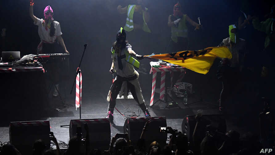 FILE - Russian feminist protest punk rock group Pussy Riot plays at La Trastienda in Montevideo, Uruguay, on April 13, 2019.