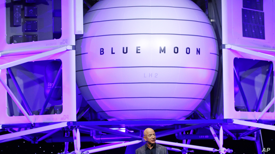 Jeff Bezos speaks in front of a model of Blue Origin's Blue Moon lunar lander, May 9, 2019, in Washington.