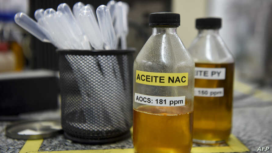 Samples of soy oil and biodiesel at the laboratory of the industrial complex of the Louis Dreyfus Company in General Lagos, Santa Fe province, Argentina, Sept. 13, 2017.