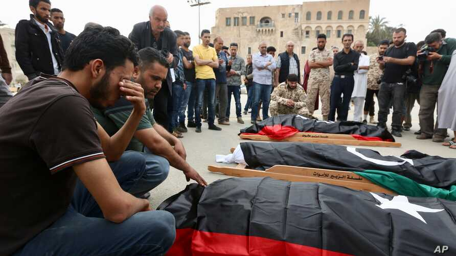 FILE - Mourners gather for funeral prayers for fighters killed by warplanes of Field Marshal Khalifa Hifter's forces, April 24, 2019, in Tripoli, Libya.