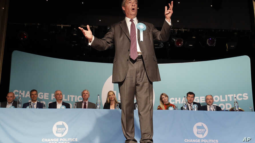 FILE - British politician Nigel Farage speaks during a Brexit Party rally at Lakeside Country Club in Frimley Green in Surrey, England, May 19, 2019.