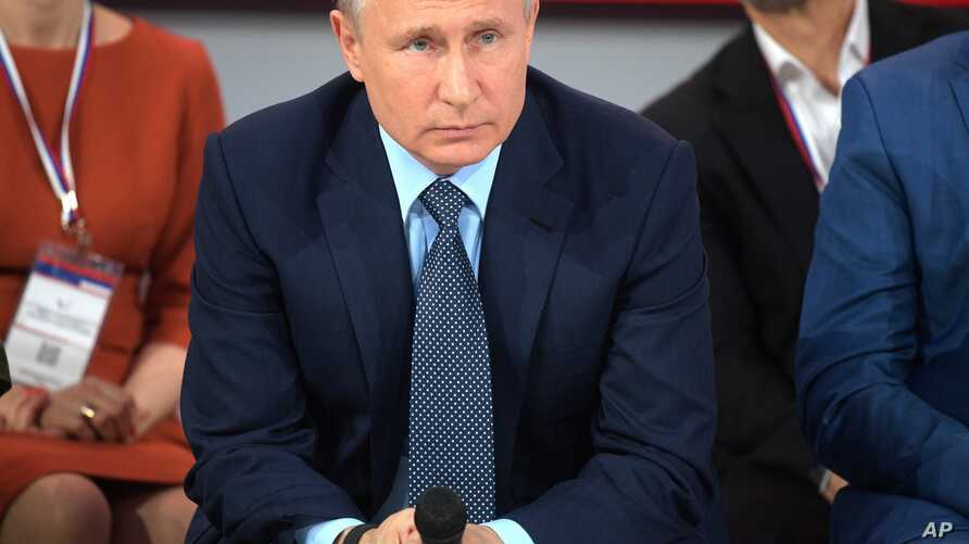 "Russian President Vladimir Putin listens to a question as he attends a meeting with ""popular front"" broad movement in the Bocharov Ruchei residence in the Black Sea resort of Moscow, Russia, May 16, 2019."
