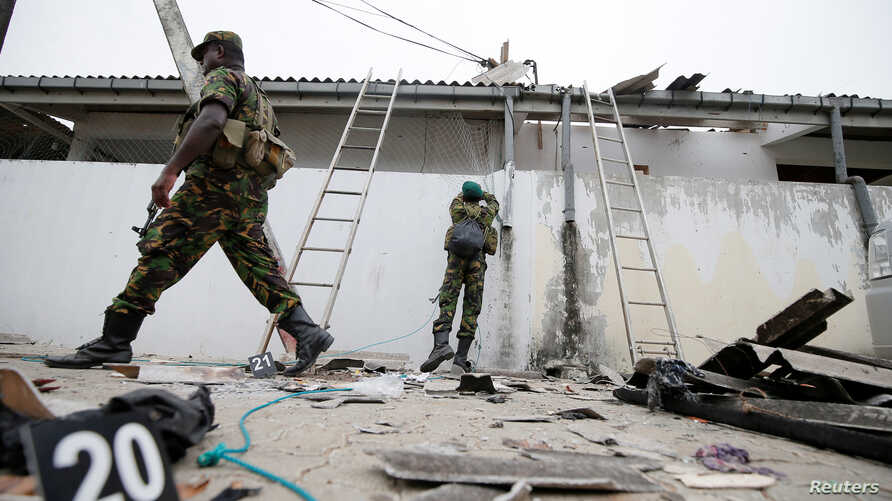Security personnel are seen at the site of an overnight gunbattle between troops and suspected Islamist militants, on the east coast of Sri Lanka, in Kalmunai, April 27, 2019.