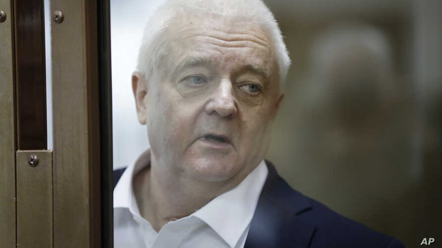 Norwegian national Frode Berg, who is accused of spying on Russia, stands inside a glass cage in a court room in Moscow, Russia, Tuesday, April 16, 2019. A Moscow court has found Berg guilty of espionage and sentenced him to 14 years in a high-securi...