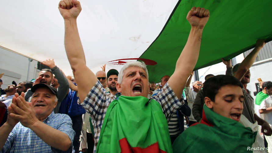 FILE - A man gestures during an anti-government protest in Algiers, Algeria, May 31, 2019.