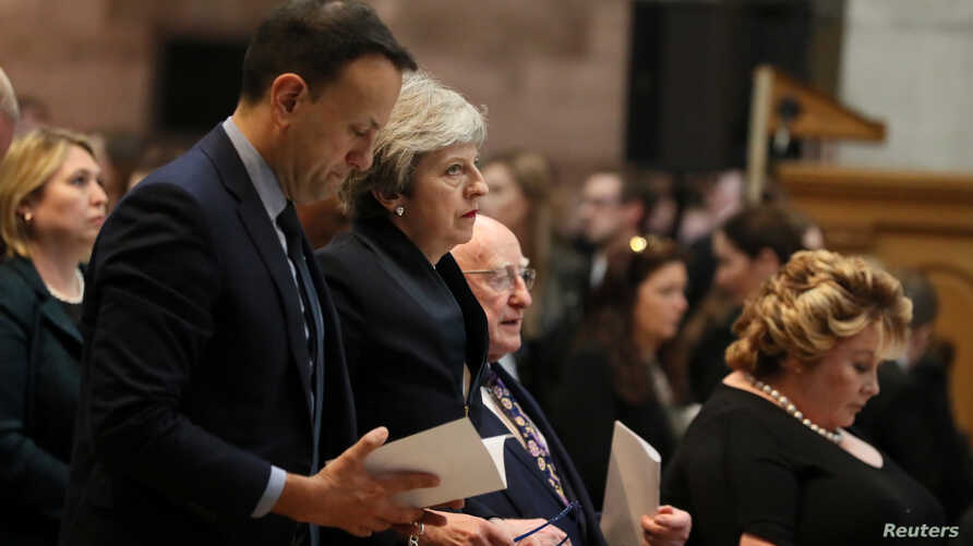 Ireland's Prime Minister (Taoiseach) Leo Varadkar, Britain's Prime Minister Theresa May and Ireland's President Michael D. Higgins attend the funeral service for murdered journalist Lyra McKee at St Anne's Cathedral in Belfast, Northern Ireland, Apr....