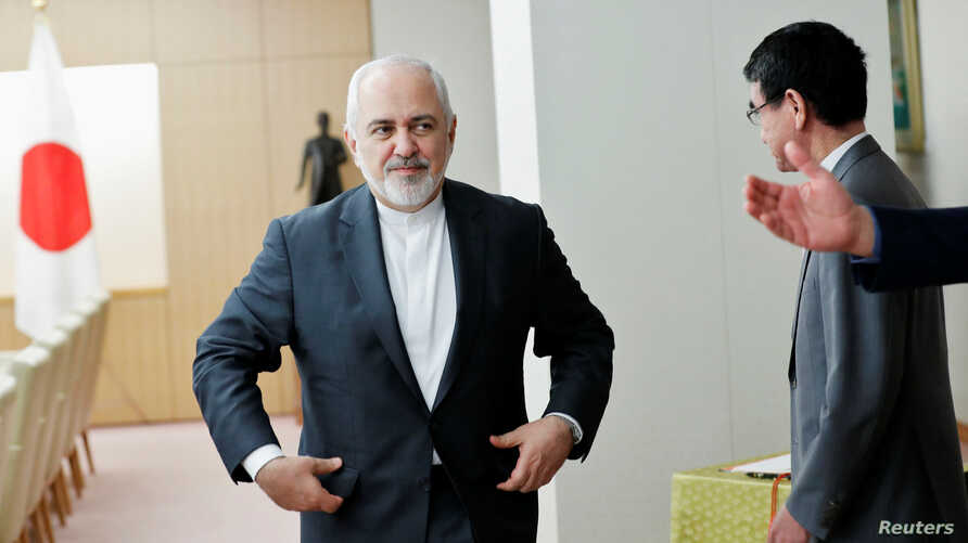 Iranian Foreign Minister Mohammad Javad Zarif (L) is guided to his seat as he meets Japanese Foreign Minister Taro Kono in Tokyo, Japan, May 16, 2019.