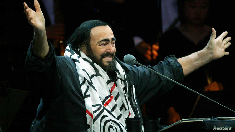 Italian opera star Luciano Pavarotti gestures during part of his round-the-world farewell tour concerts in Shanghai, China December 6, 2005.