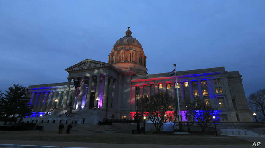 FILE - Lights shine on the Missouri Capitol in Jefferson City, Mo.
