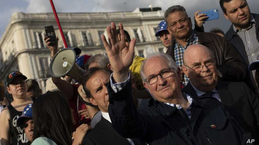 Antonio Ledezma, former mayor of Caracas, waves to supporters of Venezuelan opposition leader Juan Guaido during a gathering in Madrid, Spain,  April 30, 2019. Thousands of Venezuelans have migrated to Spain in recent years.