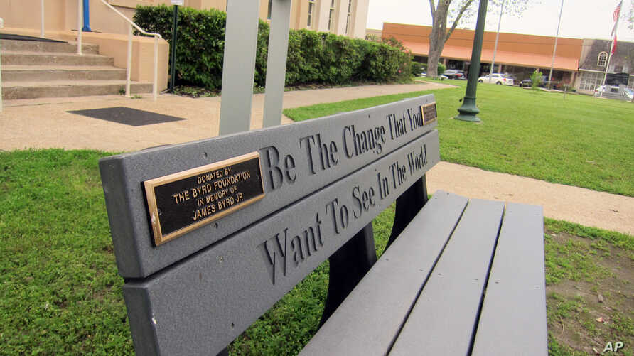 This April 12, 2019, photo shows a bench donated by a foundation started by the family of James Byrd Jr. in Jasper, Texas. The bench is located in front of the county courthouse in Jasper, Texas, where two of the three men convicted for Byrd's death ...