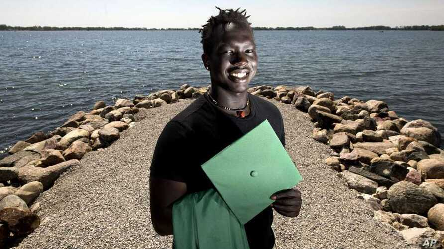 Cham Deng, a graduate of Storm Lake High, is shown in Chautauqua Park in Storm Lake, Iowa, May 15, 2019. Deng, born in the Minneapolis area to immigrants from Sudan, graduated May 19, 2019.