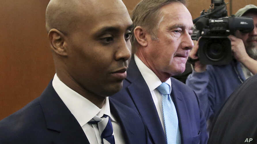 FILE -- Mohamed Noor, left, former Minneapolis police officer, leaves the Hennepin County Government Center in Minneapolis with attorney Peter Wold after a hearing to address several pretrial motions, March 1, 2019.