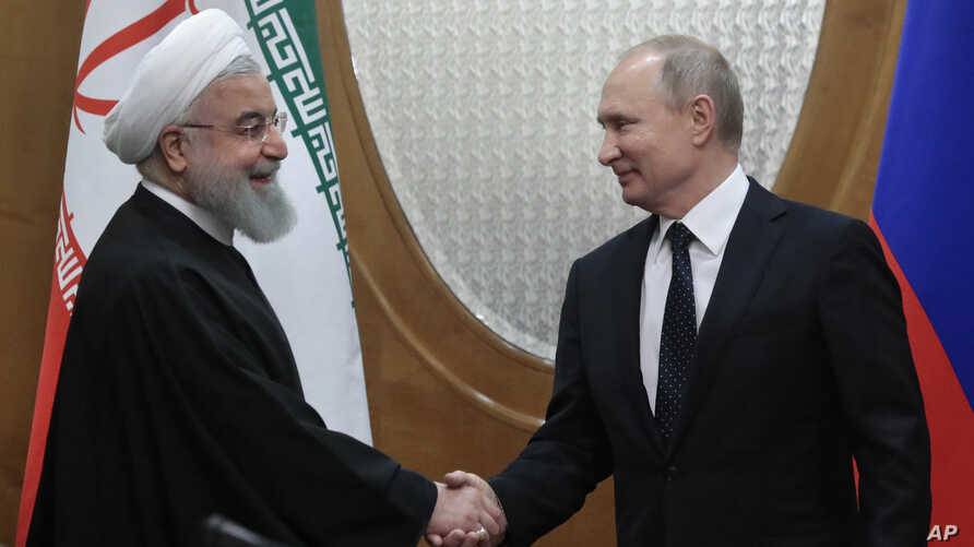 Russian President Vladimir Putin, right, and Iranian President Hassan Rouhani shake hands prior to the talks in the Bocharov Ruchei residence in the Black Sea resort of Sochi, Russia, Feb. 14, 2019.
