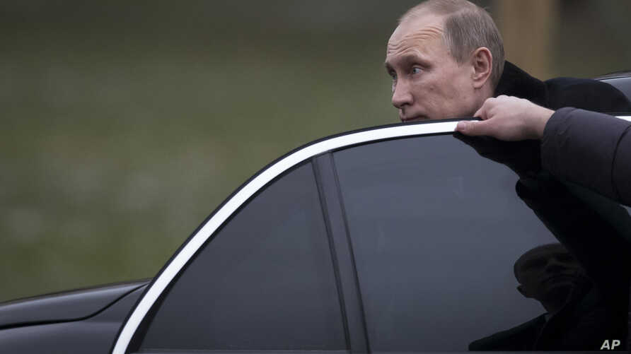 FILE - Russian President Vladimir Putin is seen getting into his limousine in Moscow, Russia, Feb. 23, 2014.