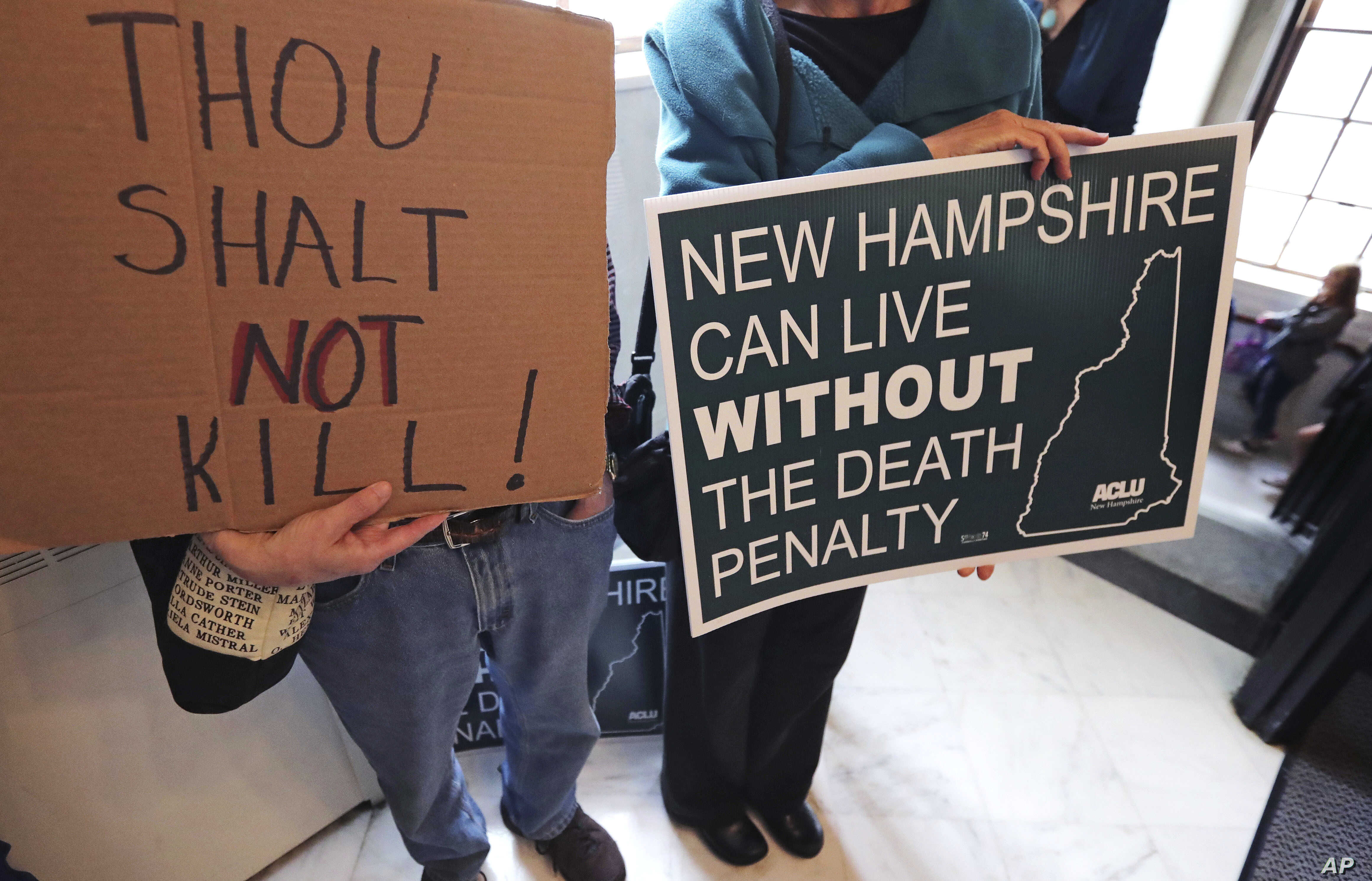 Protesters gather outside the Senate Chamber prior to a vote on the death penalty at the State House in Concord, N.H., May 30, 2019.