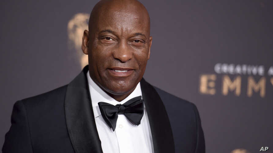 FILE - John Singleton arrives at night one of the Creative Arts Emmy Awards at the Microsoft Theater, Sept. 9, 2017, in Los Angeles.