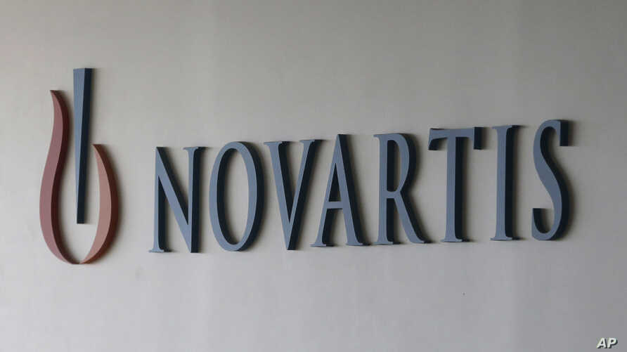 FILE - The logo of Swiss pharmaceutical company Novartis.