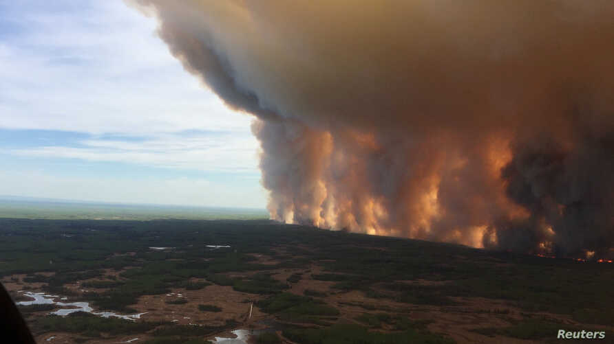 The Chuckegg Creek wildfire burns out of control in the High Level Forest Area, to the southwest and west of the town of High Level, Alberta, Canada in this May 19, 2019, picture obtained from social media.