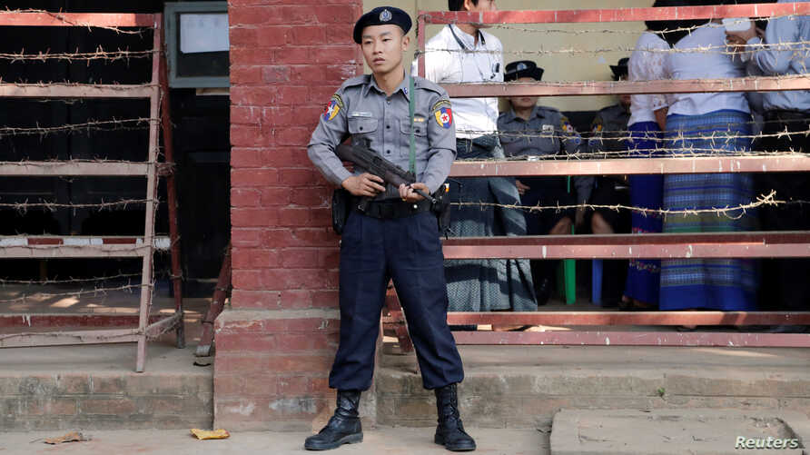 FILE - A police officer stands guard at Insein court in Yangon, Myanmar, Feb. 15, 2019.