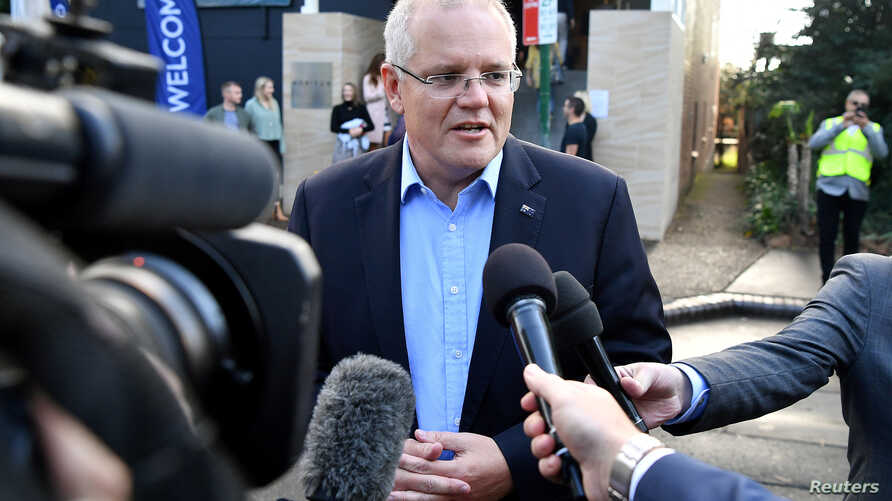 Australian Prime Minister Scott Morrison speaks to the media as he arrives at the Horizon Church in Sutherland in Sydney, Australia, May 19, 2019. (AAP Image/Joel Carrett/via Reuters)