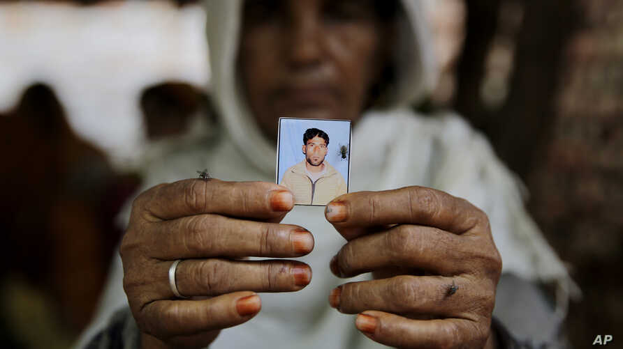 Kareeman Bano holds a photograph of her son-in-law Rakbar Khan, who died after being thrashed by a mob on suspicion of cattle smuggling, in Kolgaon village, India, July 24, 2018. A series of mob attacks on minority groups involved in cattle trade hav...