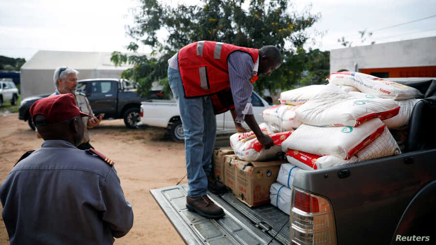 Aid workers load food onto a truck as flooding spreads in the aftermath of Cyclone Kenneth in Pemba, Mozambique, April 29, 2019.