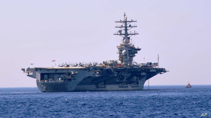 FILE - The American nuclear-powered aircraft carrier USS Dwight D. Eisenhower is seen in a July 14, 2012, photo.