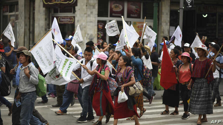 Hundreds of indigenous people, peasant farmers and activists demonstrate in the streets of Guatemala City, demanding the end of the corruption and the persecution of political leaders, May 8, 2019.