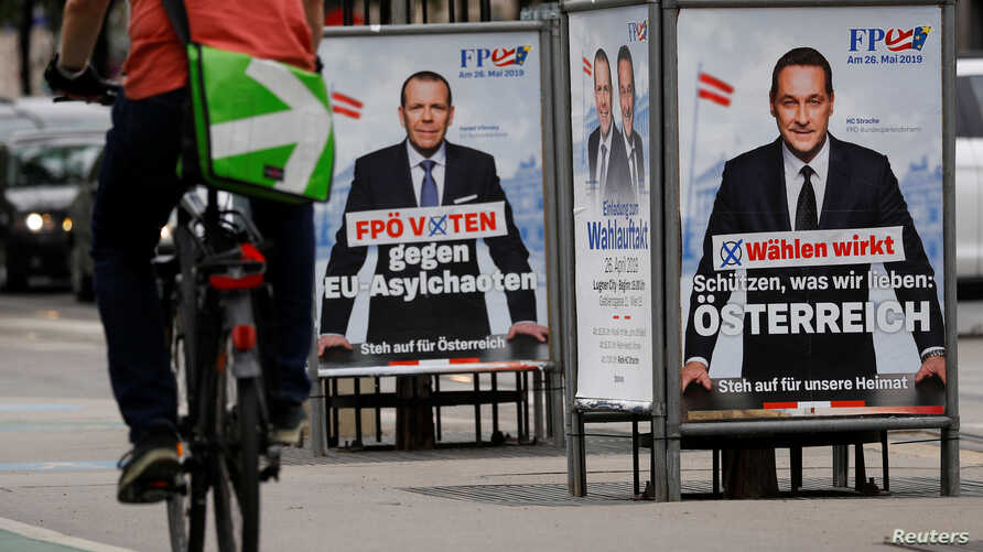A biker rides past European election posters of Austria's Vice Chancellor and Head of Freedom Party Heinz-Christian Strache and top candidate of FPOe for the European elections Harald Vilimsky in Vienna, Austria, April 26, 2019.