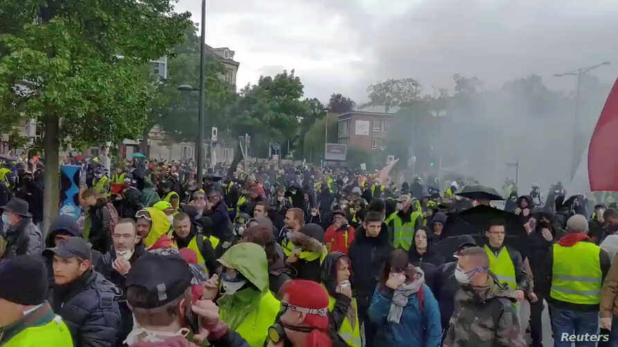 Protesters turn out for the 24th consecutive national weekly protest by the yellow vest movement in Strasbourg, France, April 27, 2019, in this still image taken from a video obtained from social media.