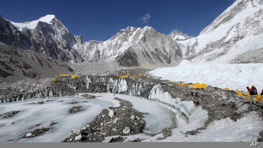 FILE - Tents are seen set up for climbers on the Khumbu Glacier, with Mount Khumbutse (C) and Khumbu Icefall (R) seen in background, at Everest Base Camp in Nepal, April 11, 2015.