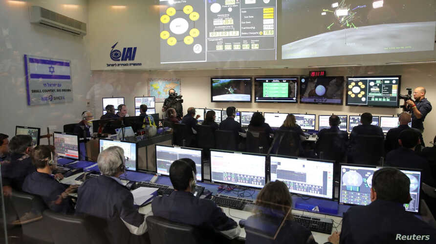 Team members of the Israel spacecraft, Beresheet, are seen in the control room in Yahud, Israel, April 11, 2019.