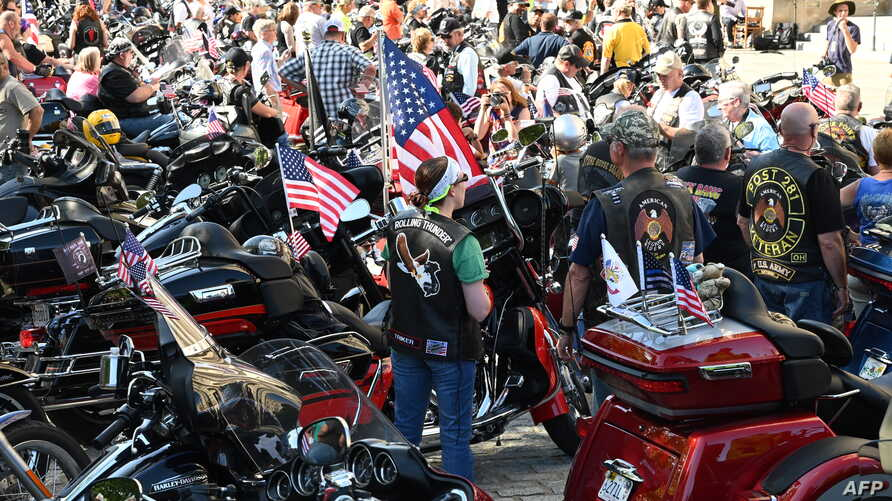 "A crowd of motorcyclists is gathered at the Washington National Cathedral for the ""Blessing of the Bikes,"" May 24, 2019, in Washington. - The Rolling Thunder First Amendment Demonstration Run, a tradition since 1988, comes to an end this Memorial Day..."