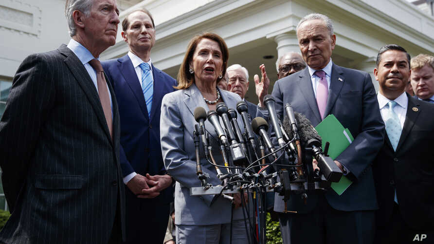 Speaker of the House Nancy Pelosi of Calif., talks with reporters after meeting with President Donald Trump about infrastructure, at the White House, April 30, 2019, in Washington.