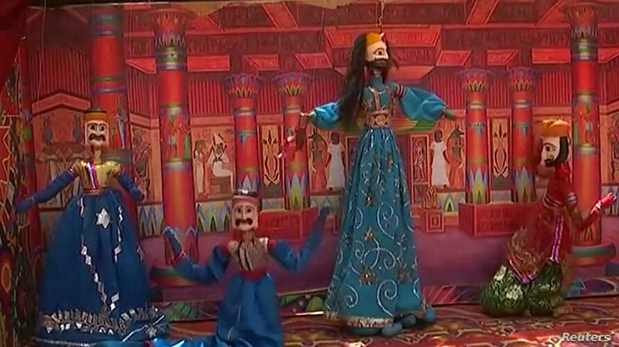 "Puppets depict the story of ""Sindbad the Sailor,"" at a show put on by Thespianz Theatre that teaches tolerance, in the Lyari neighborhood, Karachi, Pakistan."