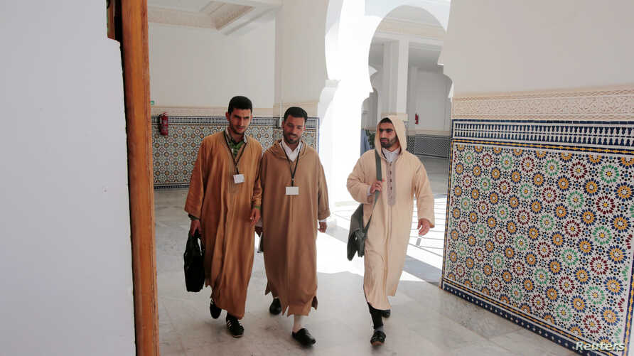 Students walk to attend religious courses at Mohammed VI Institute for training Imams in Rabat, Morocco, April 16, 2019.