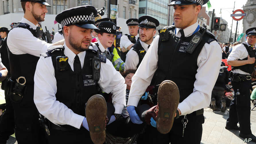 Police arrests protestors at Oxford Circus in London, Friday, April 19, 2019. The group Extinction Rebellion is calling for a week of civil disobedience against what it says is the failure to tackle the causes of climate change.