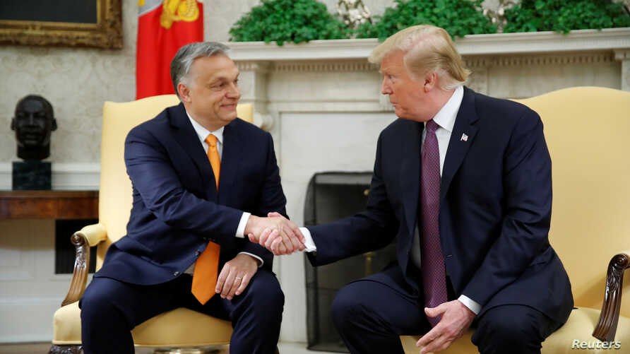 President Donald Trump greets Hungary's Prime Minister Viktor Orban in the Oval Office at the White House in Washington, U.S., May 13, 2019.