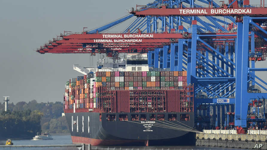 FILE - A container ship is loaded at the harbor in Hamburg, Germany, Oct. 15, 2018.