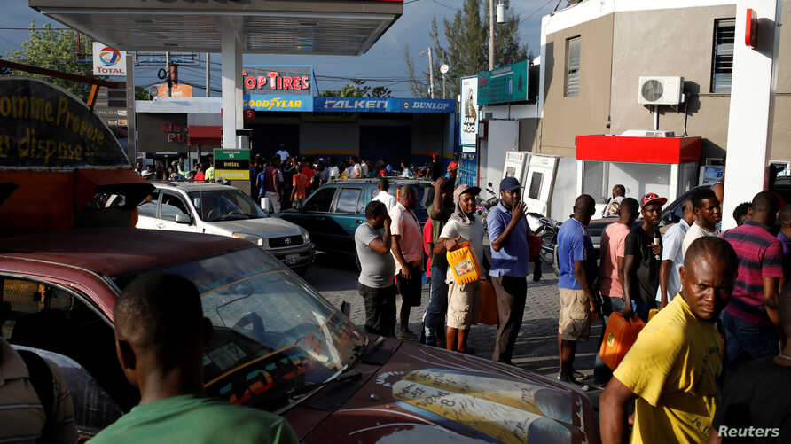 Motorbike riders and car drivers wait to get fuel at a gas station in Port-au-Prince, Haiti, April 7, 2019. Picture taken April 7, 2019.