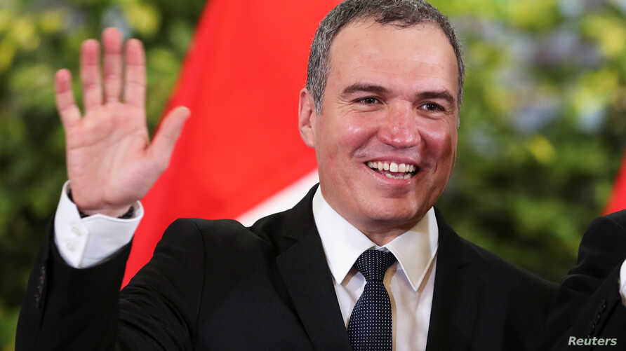 Peru's new Prime Minister Salvador del Solar waves at a swearing-in ceremony in the government palace in Lima, March 11, 2019