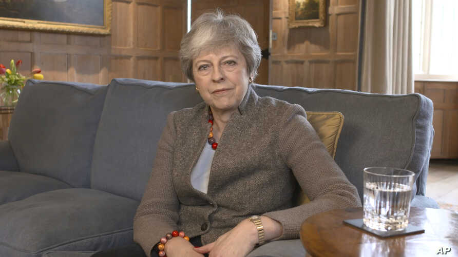 In this image taken from video released by Downing Street, April 7, 2019, showing Britain's Prime Minister Theresa May defending her position on Brexit, and her decision to hold cross-party talks with opposition Labour Party, in a video message filme...